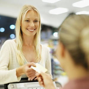 blonde lady paying with cards